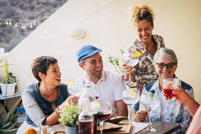 group of adults mixed ages from 40 to 80 celebrate together