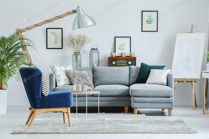 Blue armchair on grey carpet