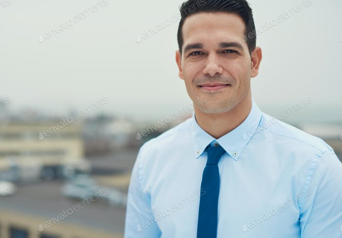 Handsome young Hispanic businessman