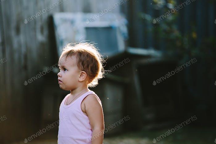 Child playing in backyard