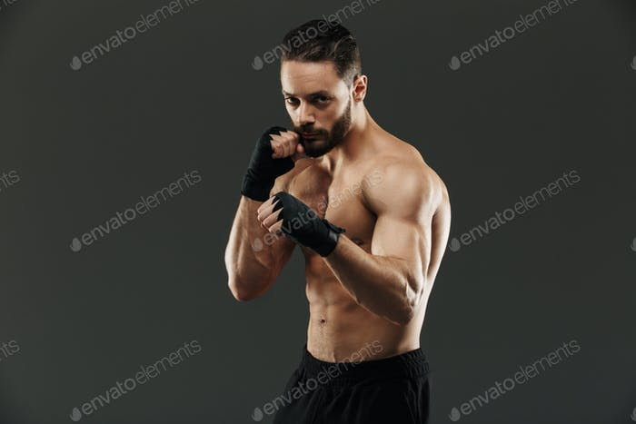 Portrait of a concentrated muscular boxer ready to fight