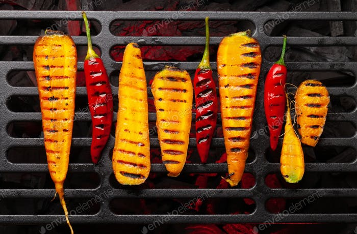Grilled vegetables cooking on grill