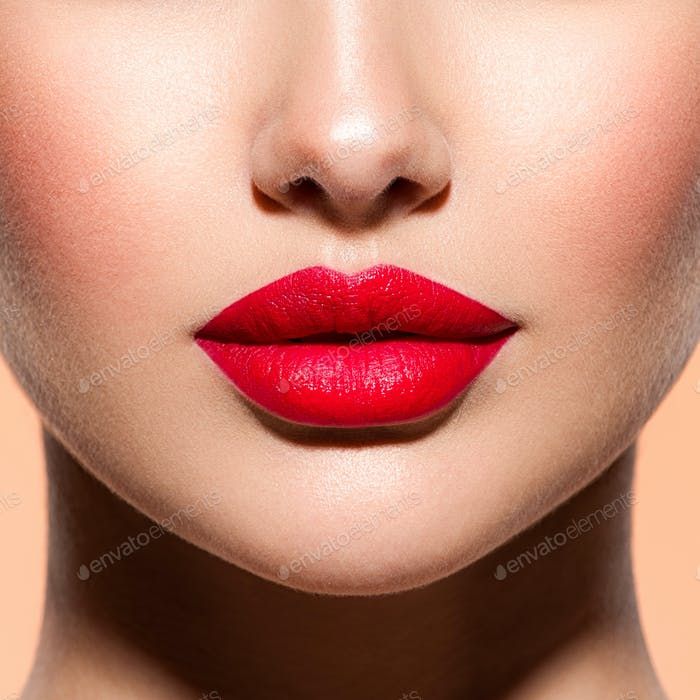 Woman lips with a red lipstick on lips. Closeup female red lips.