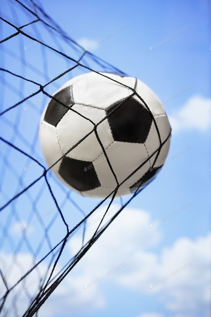 Soccer ball in back of the goal net