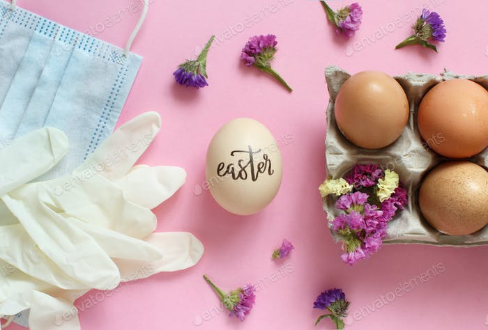 Gloves, facemask, flowers and eggs with inscription EASTER over pink background
