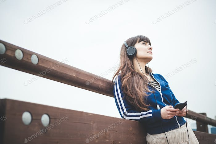 beautiful woman using smart phone and listening music