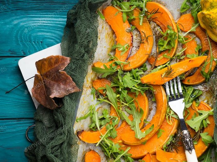 Baked pumpkin slices on tray