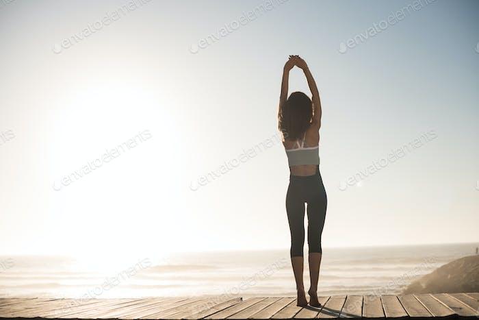 Women doing pilates on the beach
