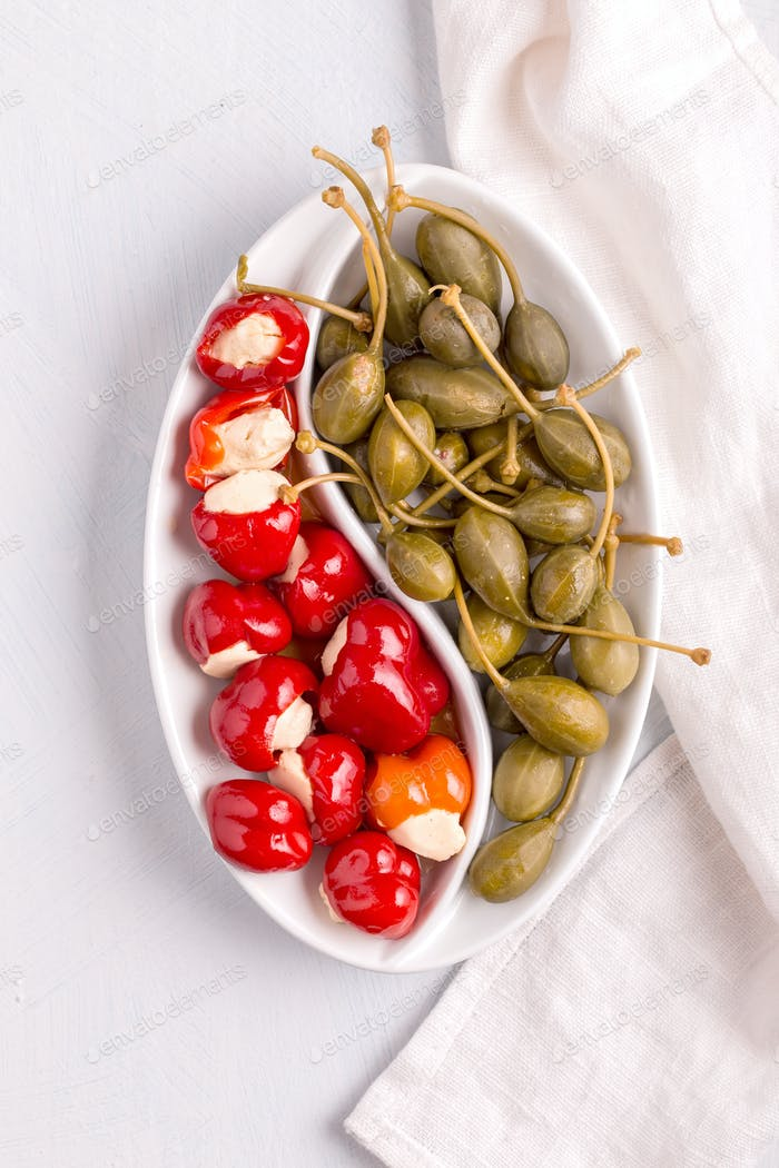 Small peppers and capers above