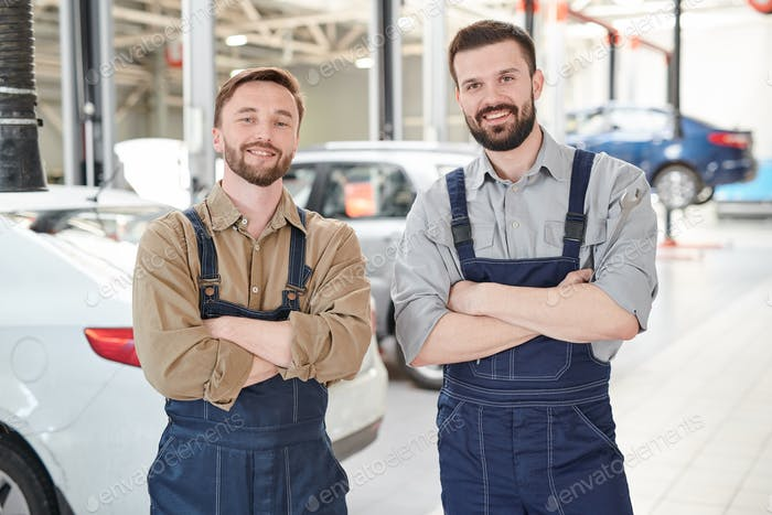 Two Workers Posing in Car Service