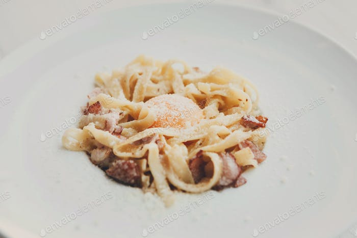 Traditional italian pasta carbonara with bacon and egg