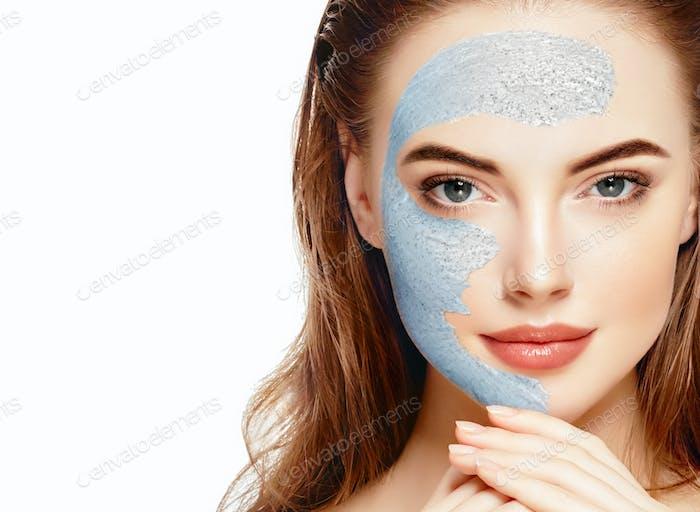 Woman spa mask half-face beauty concept healthy portrait.