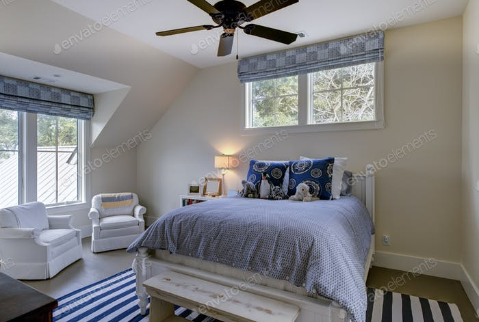 Beautiful upstairs spare bedroom with neutral colors and windows.
