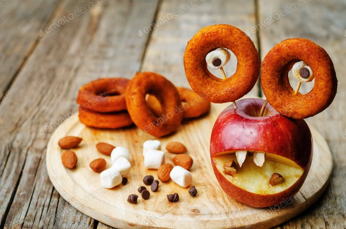 apple, marshmallows and donuts in the shape of monsters for Hall