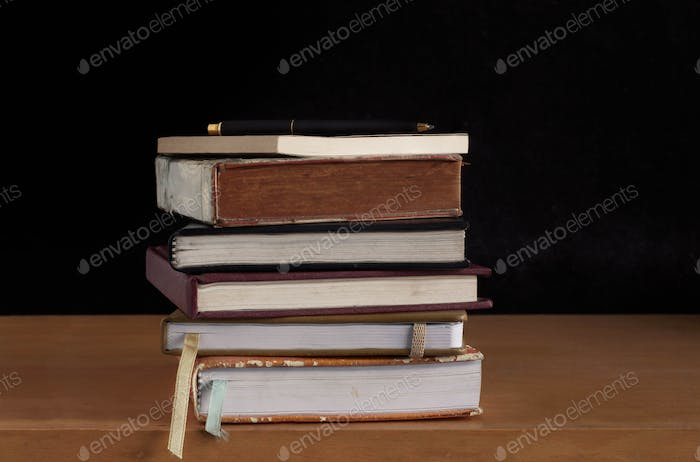 Old books with a black background