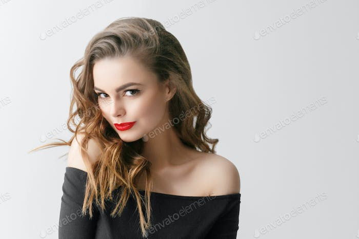 Beautiful woman with long hair and red lipstick lips beauty female portrait