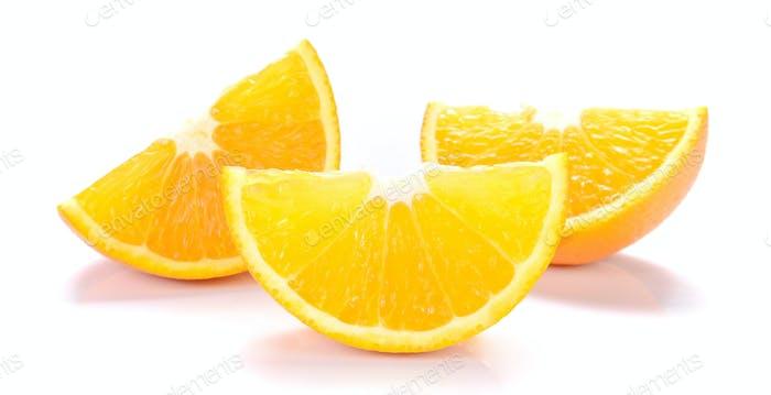 Orange cut pieces on white background.