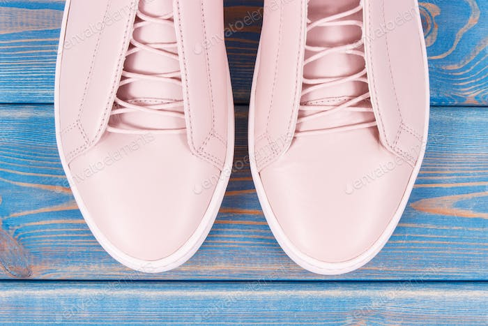 Womanly leather shoes on old blue boards