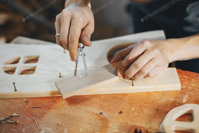 The carpenter works with a tree