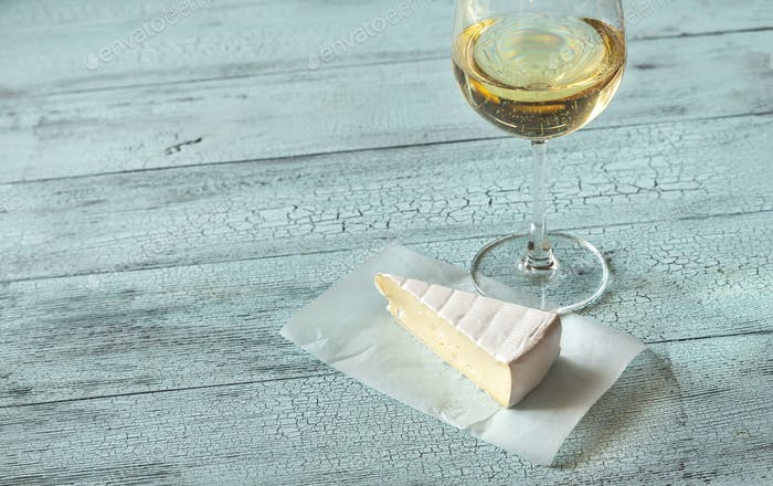 Glass of white wine with Brie