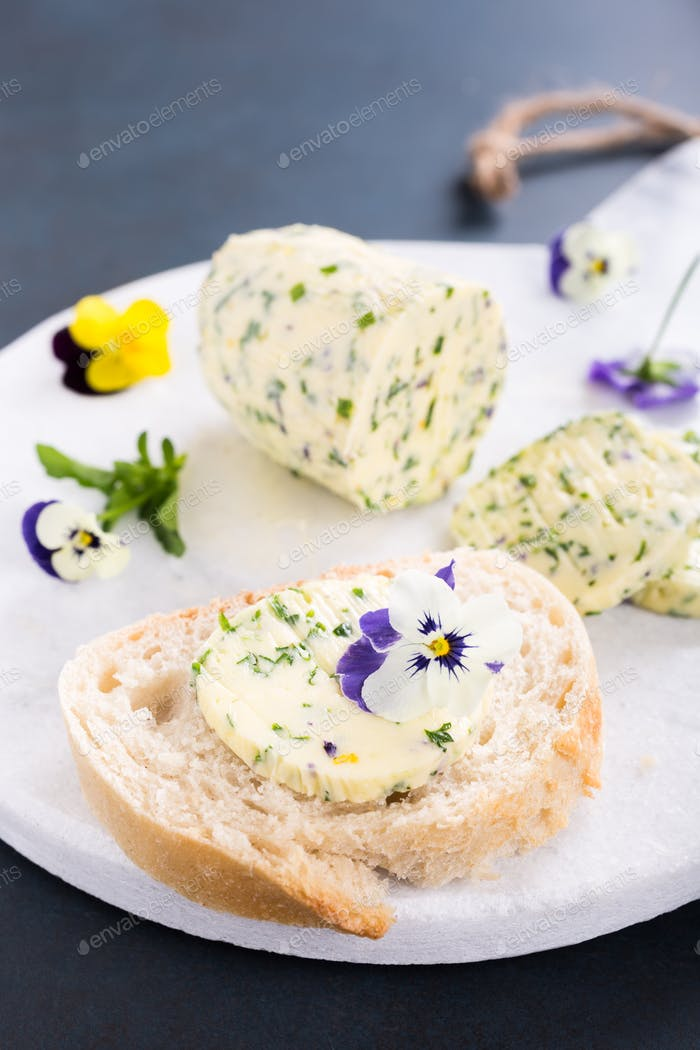 Sandwich with herb and edible flowers butter