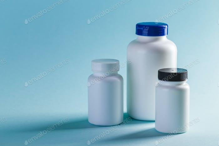 Bottle for Pills On Blue Background. Medicine Healthcare Pharmacy Concept. Coronavirus.