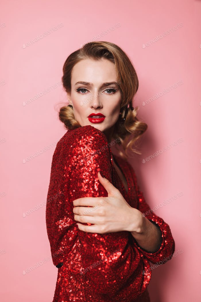 Young beautiful woman with wavy hairstyle and red lips in bright