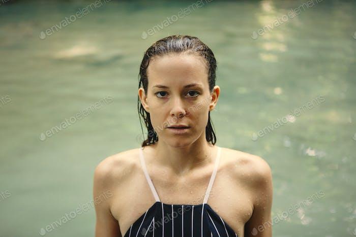 White woman enjoying the waterfall