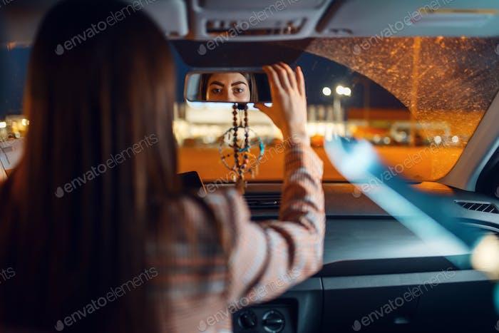 Female driver at the night, car burglar risk