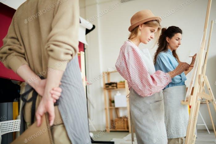 Girls painting in studio