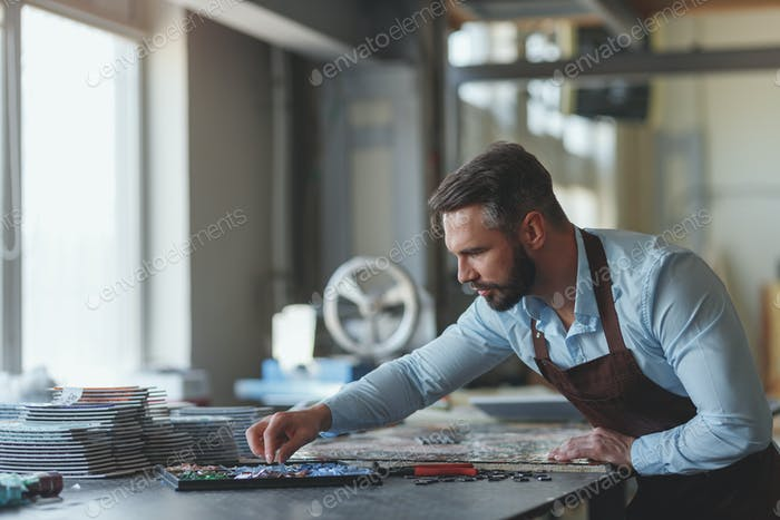 Young man at work in studio