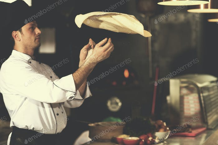 chef throwing up pizza dough