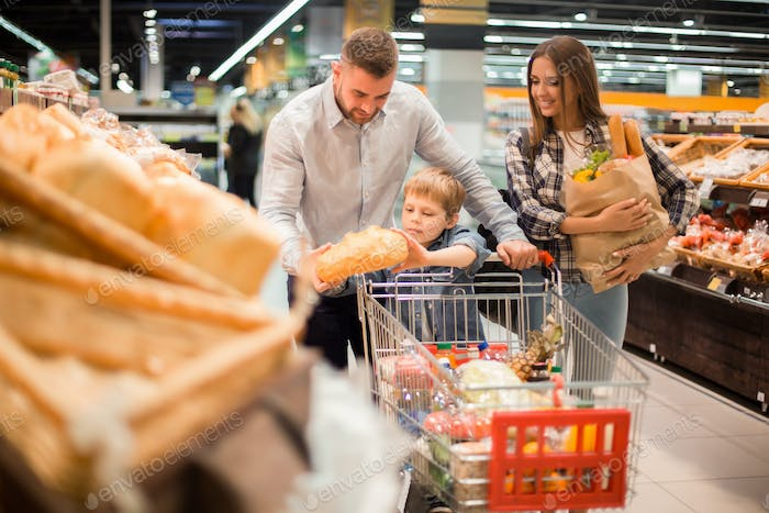 Young Family Buying Bread in Supermarket