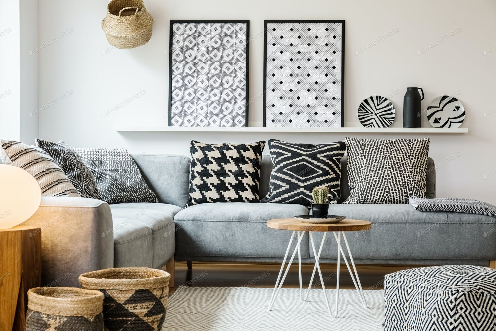 Patterned pillows on grey corner sofa in apartment interior with Foto von  bialasiewicz auf Envato Elements