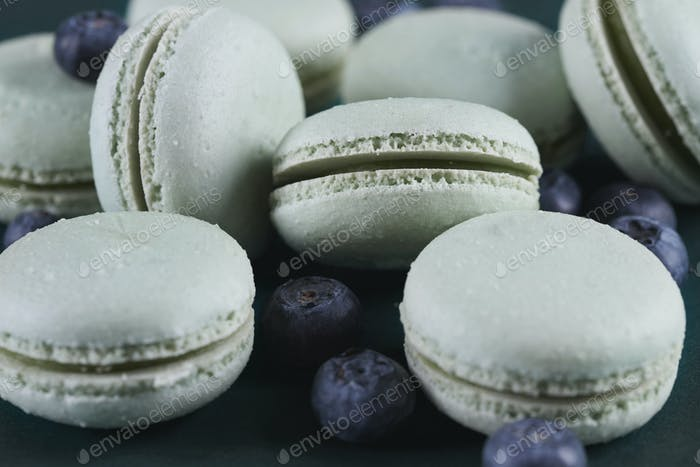 Close up of pastel macaroones with fruits