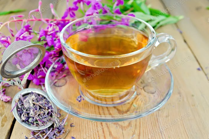 Herbal tea from fireweed in a glass cup with strainer