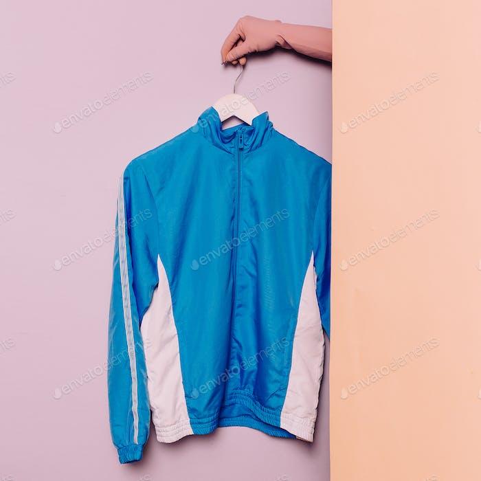 Stylish sportswear. Minimal fashion. Blue jacket on a hanger. Wa
