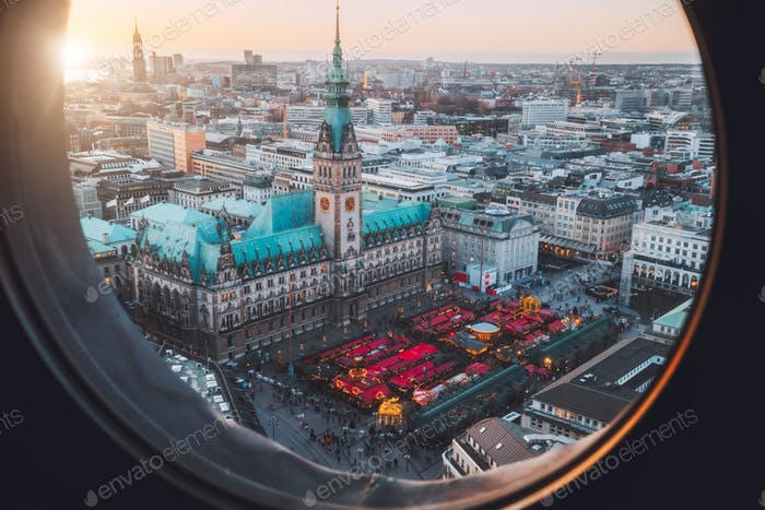 Top view of Christmas market on townhall square in advent time, Hamburg, Germany framed in porthole