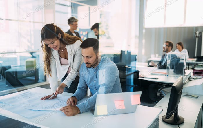 Portrait of architects having discussion in office