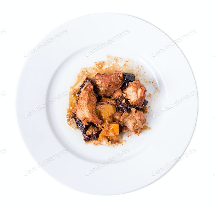 Traditional baked pork with dried plums.