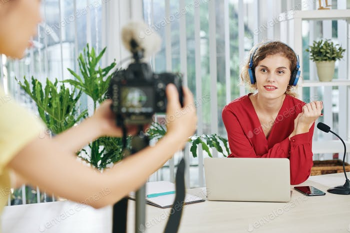 Woman filming educational video