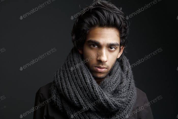 Young man with wool scarf