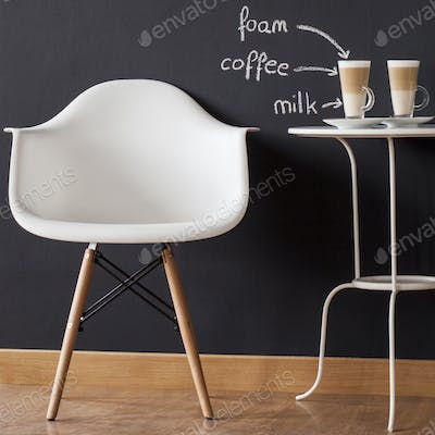 Chair and table with coffees