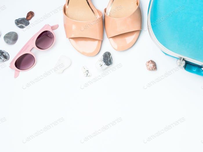 Blue suitcase, coconut, sandals, sun glasses