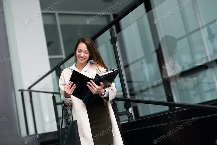 Beautiful and attractive businesswoman looking at files