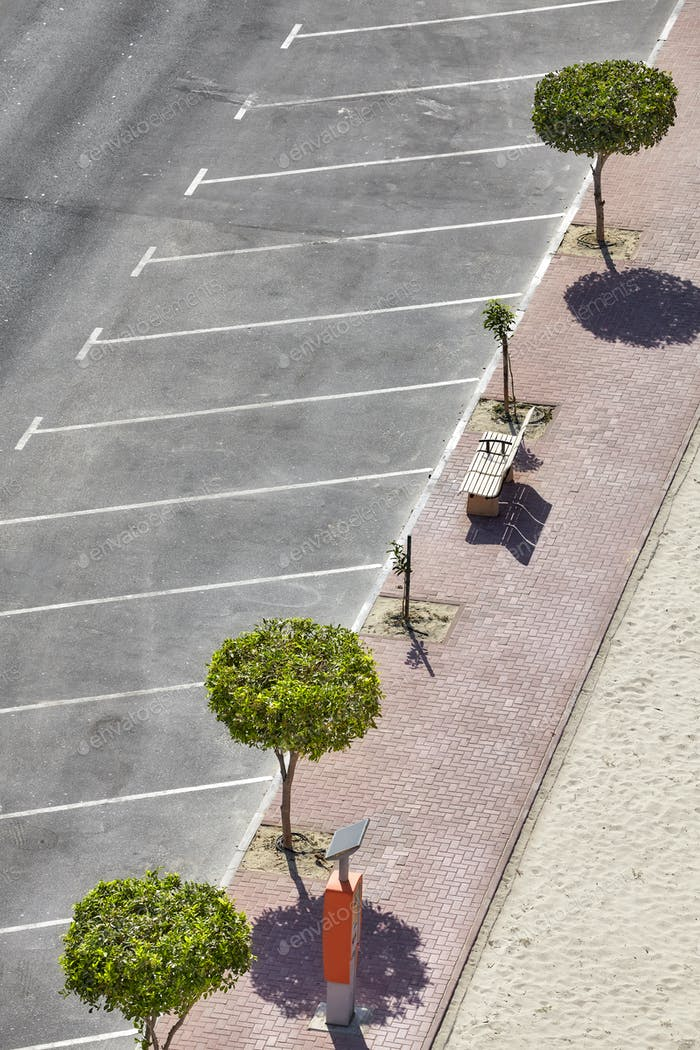 Aerial picture of an empty parking lot by a beach