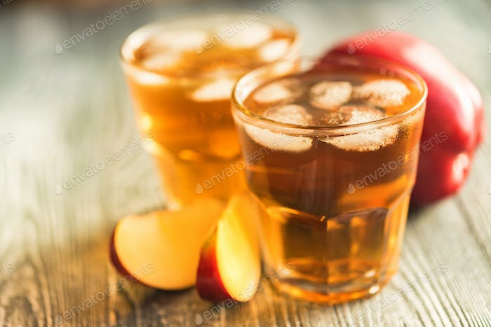 Fresh apple juice or cider in glasses on table
