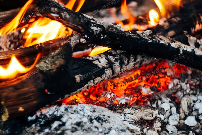 beautiful bonfire closeup, camping in mountains, travel adventure fireplace