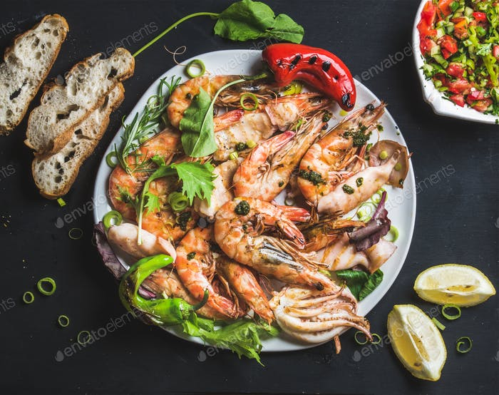 Plate of roasted tiger prawns and octopus pieces