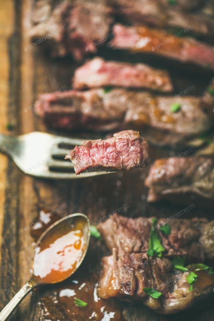 Grilled ribeye beef steak peice on fork